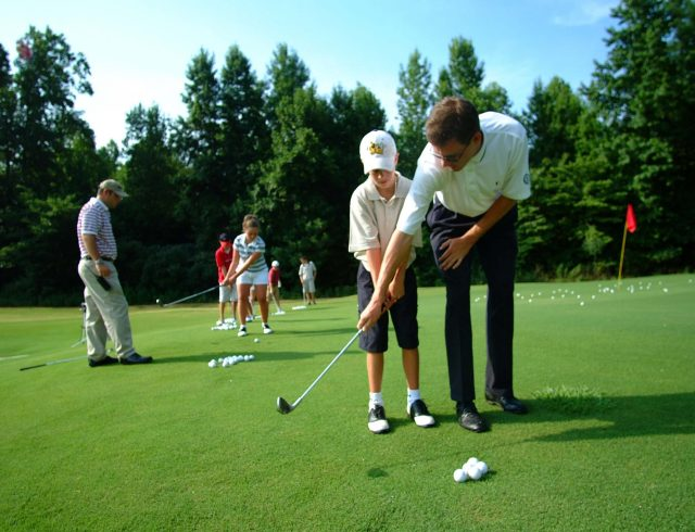 http://Golf%20instructor%20teaching%20a%20child